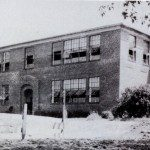 Taken from a yearbook of Mill Spring School, this photo shows the school in its original manifestation before additions were added on. Circa 1930s.