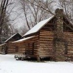 Historic log cabins in winter.