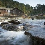 The Nantahala River runs past the NOC Outfitter's Store on a summer day, providing a scenic break for passer-bys and visitors in the Nantahala Gorge. Photo credit Steven McBride
