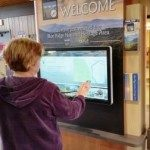 Visitor uses interactive kiosk to learn about the area.