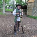 Hickory Ridge Museum founder, Dave Davis, interprets as a scout for the colonial militia.  Photo courtesy of Explore Boone Area.