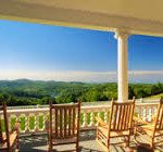 Rocking chairs on manor house porch. Photo courtesy RomanticAsheville.com.
