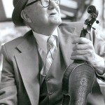"""""""Thomas Jefferson """"Tommy"""" Jarrell (1901-1985), a National Heritage Award winner, influenced modern old-time music with his intricate fiddle bowing , clawhammer banjo playing, and his rough but powerful voice. He welcomed the younger generations of musicians into his home and they spread his reputation and his music far beyond Surry County."""""""