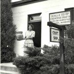 Ethelyn Conseen holds a rivercane basket at the entrance to Qualla Arts and Crafts Mutual. Clemens Kalischer photograph; Qualla Arts and Crafts Mutual, Inc.