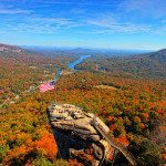 Chimney Rock at Chimney  Rock State Park is known the world over for its spectacular fall foliage. Located in a thermal belt, fall colors in the Park   usually begin slightly after and last longer than those in higher elevations. Photo by Chuck Hill Photography.
