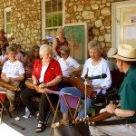 The Friendship Dulcimer Association participates in museum events, festivals and often plays on the front porch on Sunday afternoons.  Credit Mountain Gateway Museum.