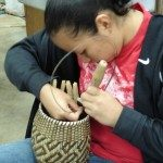 Cherokee High School student Hannah Youngdeer learns the tradition of basket making using techniques handed down through generations.  Photo courtesy of Revitalization of Traditional Cherokee Artisan Resources (RTCAR) and Hannah Youngdeer.